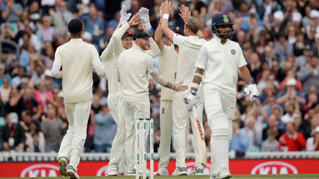 England's Stuart Broad celebrates after taking the wicket of India's Shikhar Dhawan at the Oval  in London on Saturday.