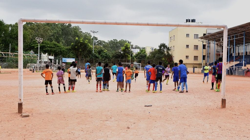 The Gowthamapuram stadium is a little more than half the size of a regular football field, with a couple of goal posts on one side and a concrete stand at the other.
