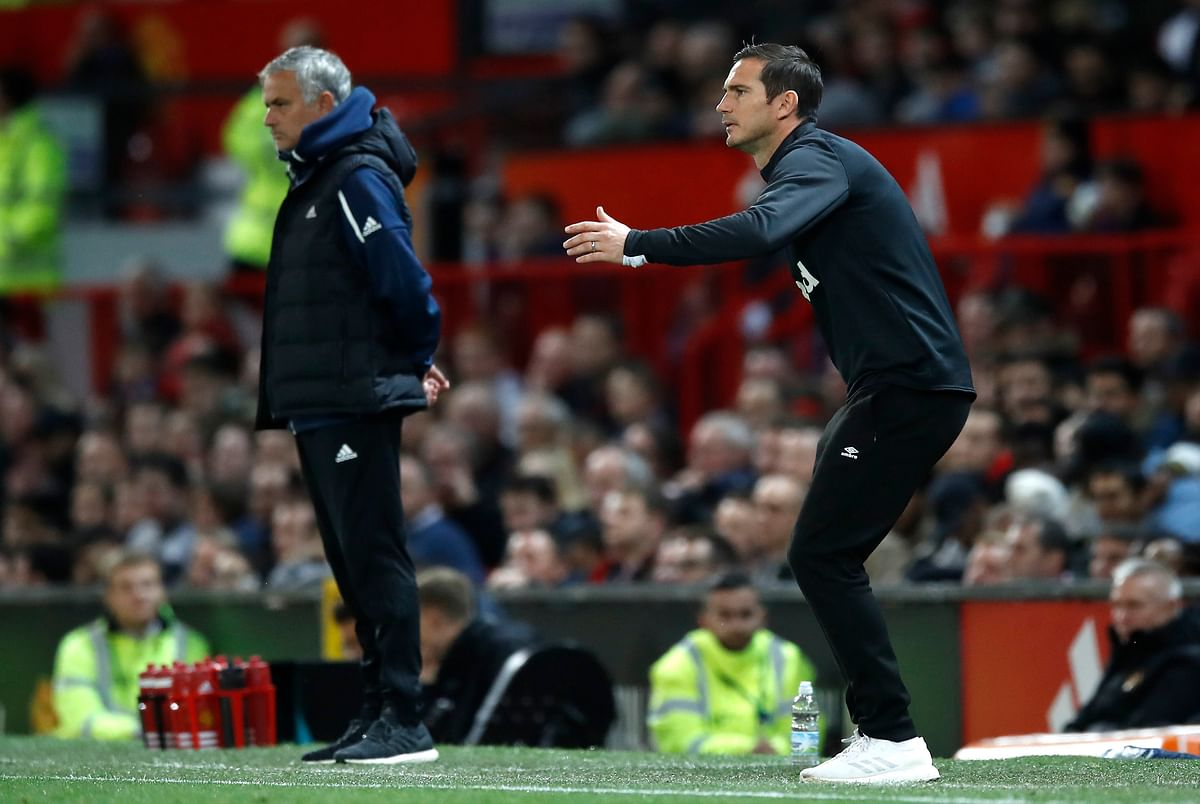 Derby County manager Frank Lampard gestures on the touchline with Manchester United manager Jose Mourinho, left, during their English League Cup.