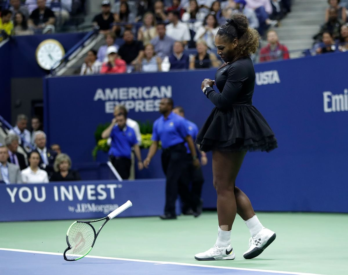 Serena Williams slams her racket on the court during the women's final of the US Open.