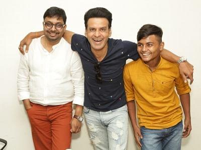 New Delhi: Actors Manoj Bajpayee and Om Singh with filmmaker Dipesh Jain at IANS Office in New Delhi, on Aug 31, 2018. (Photo: Amlan Paliwal/IANS)
