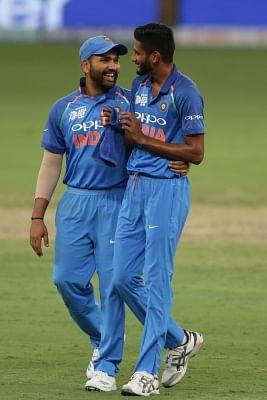 Dubai: Indian skipper Rohit Sharma along with Khaleel Ahmed celebrates after winning the fourth match (Group A) of Asia Cup 2018 against Hong Kong at Dubai International Cricket Stadium on Sept 18, 2018. (Photo: Surjeet Yadav/IANS)