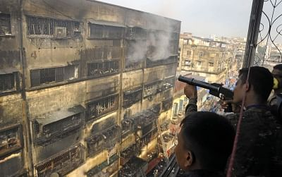 Kolkata: Rubber bullets being used to break the window panes of Bagri market where a fire broke out on Sunday, in order to make the smoke escape, during fire fighting operations, in Kolkata on Sept 19, 2018. (Photo: Kuntal Chakrabarty/IANS)