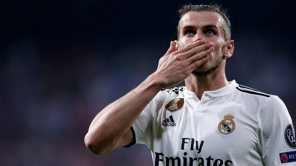 Real midfielder Gareth Bale celebrates after scoring his side's second goal during their Champions League match against Roma  in Madrid on Wednesday.