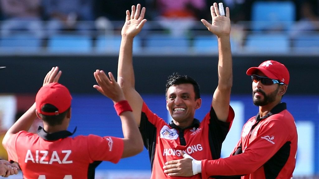 Hong Kong's off-spinner Ehsan Khan celebrating the fall of India's Mahendra Singh Dhoni's wicket on Tuesday.