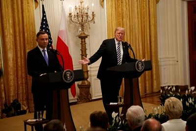 WASHINGTON D.C., Sept. 19, 2018 (Xinhua) -- U.S. President Donald Trump (R) and visiting Polish President Andrzej Duda attend a joint press conference at the White House in Washington D.C. Sept. 18, 2018. Donald Trump said on Tuesday that the U.S. was weighing the idea of establishing a permanent military base in Poland, a proposal raised by the visiting Polish leader. (Xinhua/Ting Shen/IANS)