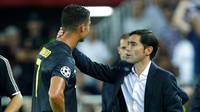 Juventus' Cristiano Ronaldo is consoled by Valencia coach Marcelino Garcia as he walks off the pitch after getting a red card during the Champions League match against Valencia on Wednesday.