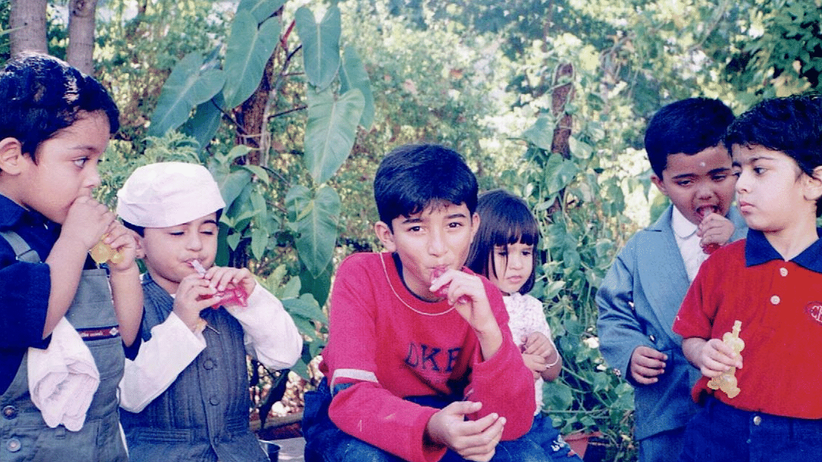 Adi, in the middle, surrounded by other kids from school.