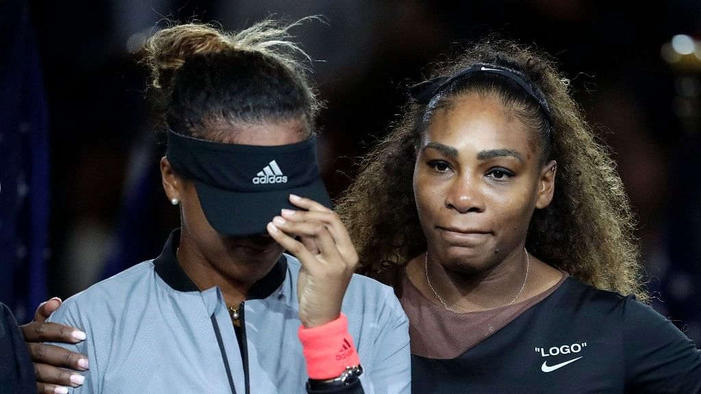 Japan's Naomi Osaka is hugged by Serena Williams after Osaka defeated Williams in the women's final of the US Open tournament on Saturday.