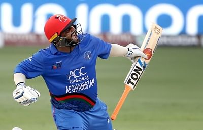 Dubai: Mohammad Shahzad of Afghanistan celebrates his century during the fifth match of Asia Cup 2018 Super Four between India and Afghanistan at Dubai International Cricket Stadium in Dubai, UAE on Sept 25, 2018. (Photo: Surjeet Yadav/IANS)