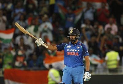 Dubai: Indian skipper Rohit Sharma celebrates his half century during the fifth match (Group A) of Asia Cup 2018 between India and Pakistan at Dubai International Cricket Stadium on Sept 19, 2018. (Photo: Surjeet Yadav/IANS)