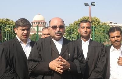 New Delhi: Advocate Barun Kumar Sinha, appearing for a group of lawyers, talks to the media outside the Supreme Court, in New Delhi on Sept 27, 2018. The Supreme Court on Thursday rejected a plea for referring the Ramjanambhoomi-Babri Masjid dispute to a larger Constitutional Bench and decided that a newly set up three-judge bench will hear the case from October 29. (Photo: IANS)