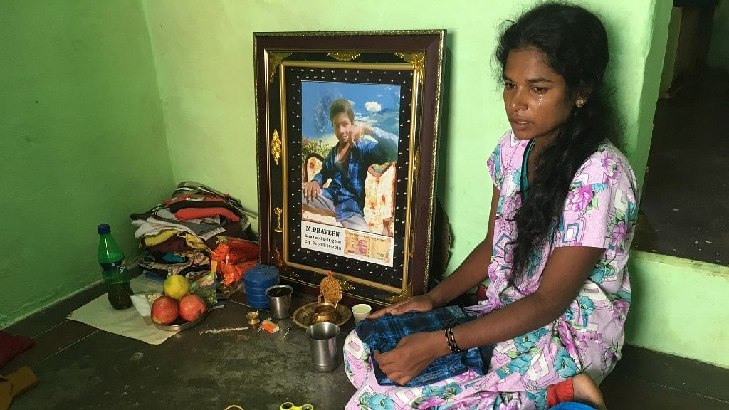Murugamma sits beside a framed picture of her 10-year-old son Praveen, who succumbed to dog bite injuries on 1 September.