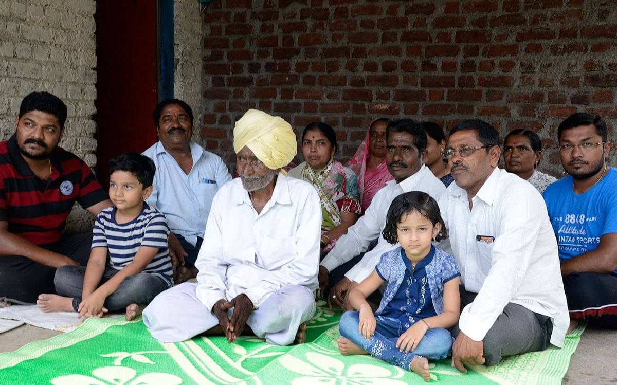 Ganpati Yadav with his great grandchildren and other family members, among them sons Nivrutti (on the left at the back), Chandrakant (on the left in the front) and Mahadev (bespectacled, on the right in the front)