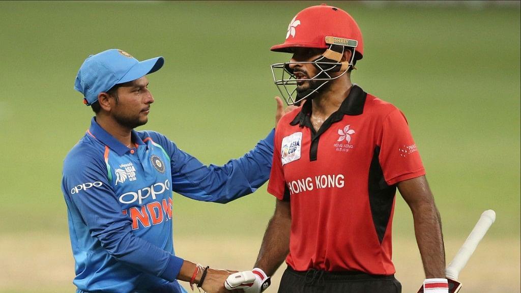 Kuldeep Yadav congratulating a Hong Kong player.