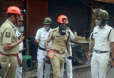 Kolkata: Police personnel during firefighting operations at Bagri market where a fire broke out on Sunday; in Kolkata on Sept 19, 2018. (Photo: Kuntal Chakrabarty/IANS)