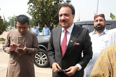 ISLAMABAD, Sept. 4, 2018 (Xinhua) -- Former interior minister Rehman Malik (front) arrives to cast his vote at the National Assembly during the presidential election in Islamabad, capital of Pakistan on Sept. 4, 2018. Polling for presidential election kicked off Tuesday in Pakistan with three candidates competing for the slot of the 13th president of the country for the next five-year term.  (Xinhua/Ahmad Kamal/IANS)