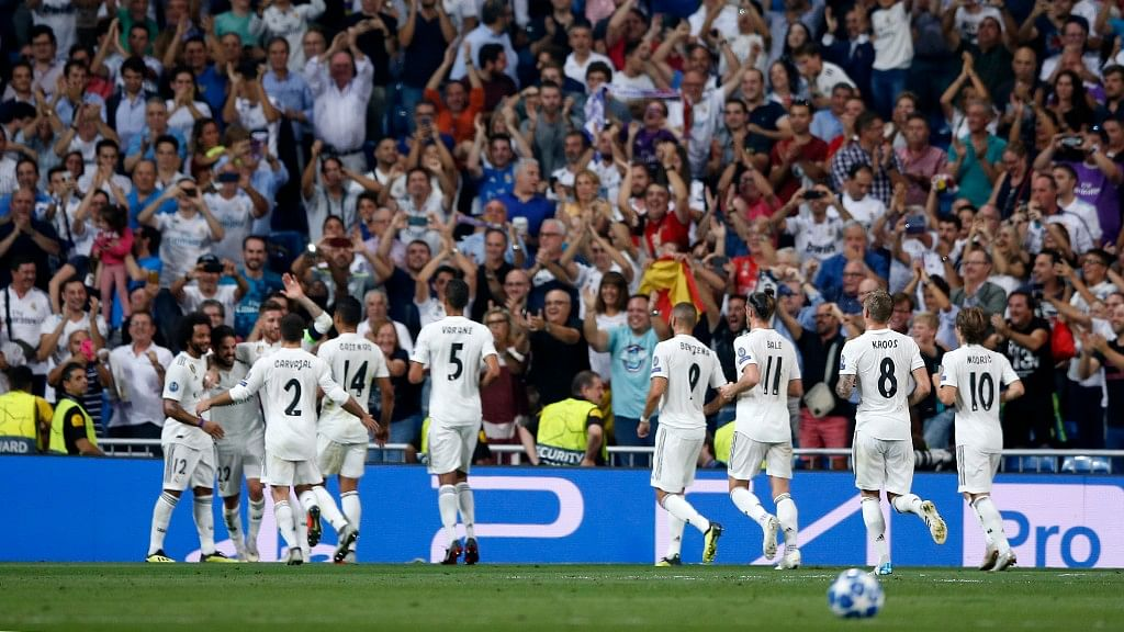 Real midfielder Isco celebrates with teammates after scoring his side's opening goal during their  Champions League match against Roma in Madrid on Wednesday.