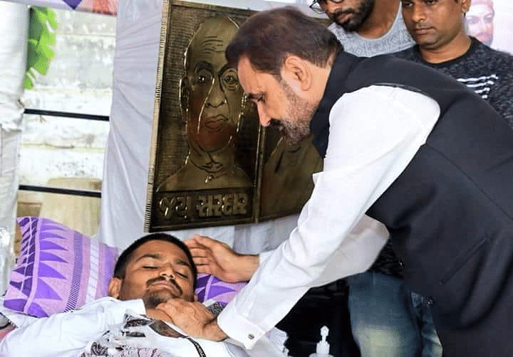 Shaktisinh Gohil of the Congress party meets Hardik on day 10 of his fast.