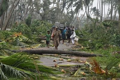 Srikakulam: Uprooted trees block a street after severe cyclonic storm Titli wrecked havoc in Srikakulam district of Andhra Pradesh on Oct 11, 2018. The cyclone, which made landfall between Andhra Pradesh and Odisha early on Thursday, uprooted trees, electricity poles and communication towers and also damaged crops. (Photo: IANS)