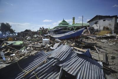 POSO, Oct. 10, 2018 (Xinhua) -- A stranded wooden boat is seen after an earthquake and tsunami at Pantoloan port in Poso, Central Sulawesi Province, Indonesia, on Oct. 10, 2018. The earthquakes and the tsunami have killed at least 2,010 people, left over 5,000 others missing and triggered massive damage and a huge evacuation, according to the national disaster management agency. (Xinhua/Zulkarnain/IANS)