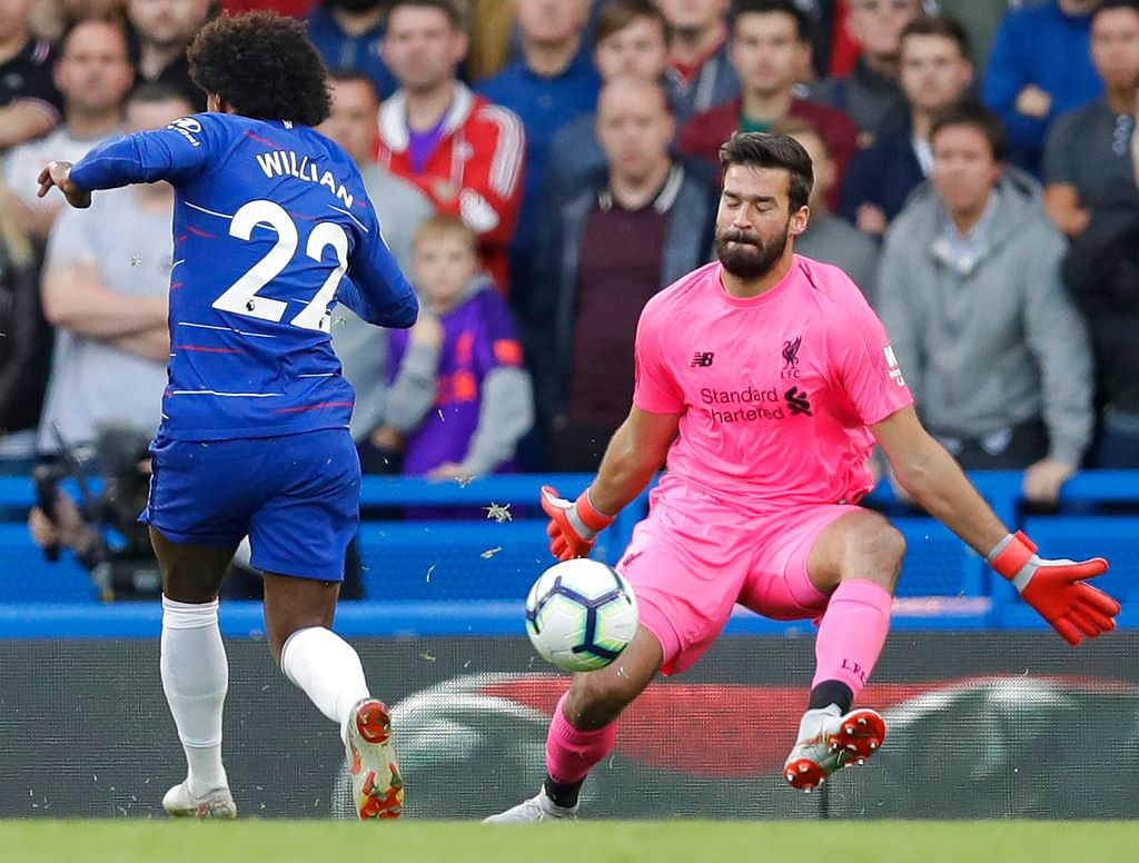 Liverpool's goalkeeper Alisson Becker makes a save during the Premier League match against Chelsea.