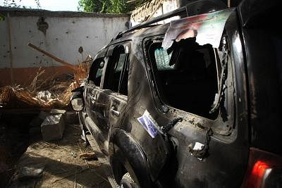 JALALABAD, Oct. 2, 2018 (Xinhua) -- Photo taken on Oct. 2, 2018 shows a damaged vehicle at the site of an attack in Kama district of Nangarhar province, Afghanistan. At least 13 people were killed and 30 others wounded after a suicide bombing ripped through an election rally in Afghanistan