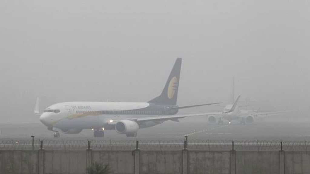 File image of a flight at Delhi airport during fog.