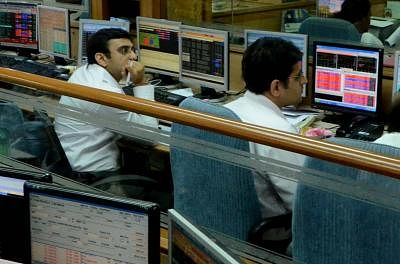 A stock broker looks at the Bombay Stock Exchange trading terminal as the BSE sensex is down by 800 points. (File Photo Sandeep Mahankal/IANS)