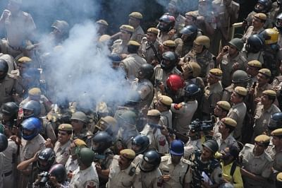 New Delhi: Police fire tear gas shells to disperse protesting farmers at the Uttar Pradesh-Delhi border on Oct 2, 2018. The protest by thousands of farmers turned violent as they tried to break barricades and run them over with tractors to enter the national capital. The police action led to several injuries while one of the protestors lost consciousness. The farmers, who were marching to Delhi from Haridwar under the banner of Kisan Kranti Yatra demanding complete loan waiver and reduction in e