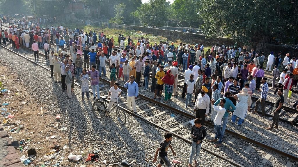 A crowd at the site of the train accident in Amritsar.