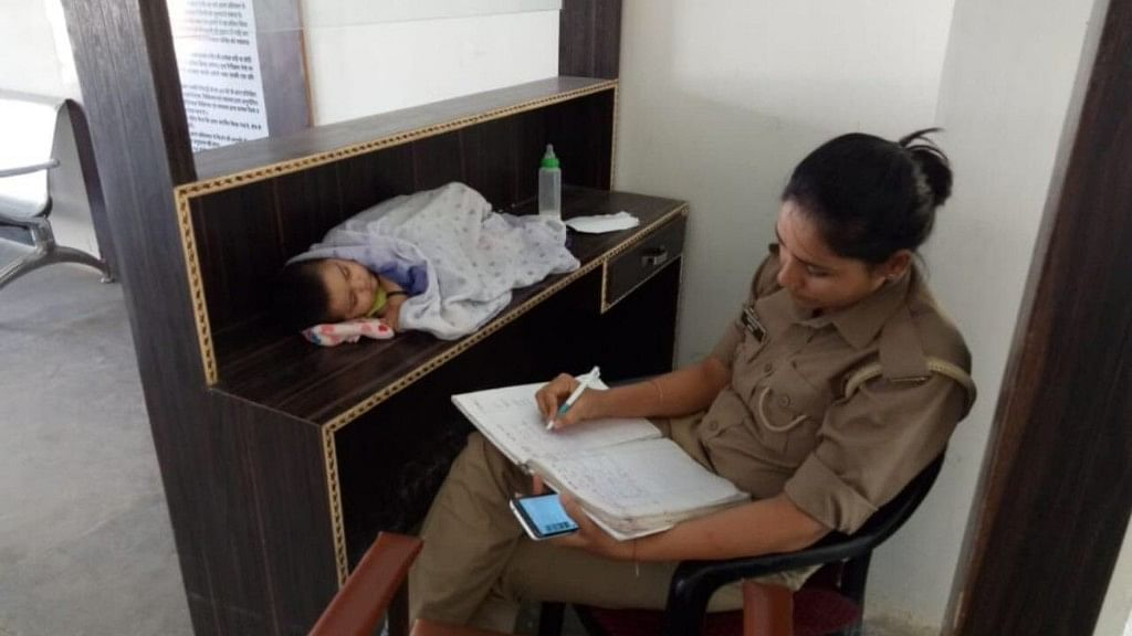 Woman Cop Works With  Baby by Her Side, Gets Transferred Near Home