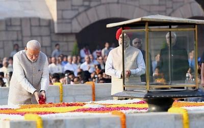 New Delhi: Prime Minister Narendra Modi pays floral tributes at the Samadhi of Mahatma Gandhi at Rajghat on Gandhi Jayanti in New Delhi, on Oct 2, 2018. (Photo: IANS/PIB)