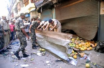 Dum Dum:  Police carry out investigations at the site of an explosion, in Dum Dum, West Bengal, on Oct 2, 2018. An eight-year-old boy was killed and at least nine persons were injured in the crude bomb blast in Dumdum in West Bengal