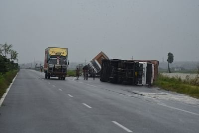 Srikakulam: Trucks lay overturned at a street after severe cyclonic storm Titli wrecked havoc in Srikakulam district of Andhra Pradesh on Oct 11, 2018. The cyclone, which made landfall between Andhra Pradesh and Odisha early on Thursday, uprooted trees, electricity poles and communication towers and also damaged crops. (Photo: IANS)