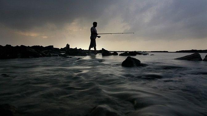 A fisherman catching fish in the Arabian Sea, Mumbai. Image used for representational purposes.
