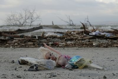 PALU, Oct. 10, 2018 (Xinhua) -- Photo taken on Oct. 10, 2018 shows an abandoned doll in Palu, Central Sulawesi, Indonesia. The Indonesian national disaster agency put the death toll from multiple strong quakes and an ensuing tsunami in Central Sulawesi province at 2,045 on Wednesday, a day before the search operation ended. (Xinhua/Wang Shen/IANS)