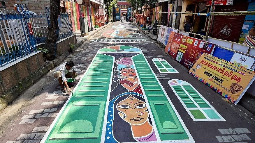 The graffiti, painted on a 300 feet long stretch of road in Ahiritola area, tells the tale of hardships and the circumstances that force a woman to get into the flesh trade.