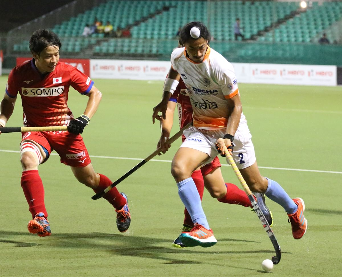 Dilpreet Singh was awarded a yellow card for pushing a Japanese player.