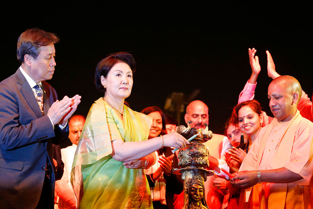 South Korean culture, sports and tourism minister Do Jong-hwan, left, applauds as Kim Jung-Sook, second left, wife of South Korean President Moon Jae-in, left, lights an oil lamp during Diwali celebrations in Ayodhya.