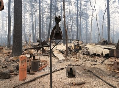PARADISE, Nov. 14, 2018 (Xinhua) -- Debris are seen after the wildfire in Paradise, California, the United States, on Nov. 13, 2018. The death toll from the raging Camp Fire in the U.S. state of California has increased to 48 as rescuers continue to search for missing residents in and around the town of Paradise, local authorities said Tuesday. (Xinhua/Li Ying/IANS)