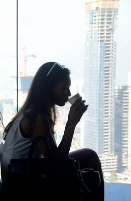 A woman holds a cup. (File Photo: IANS)