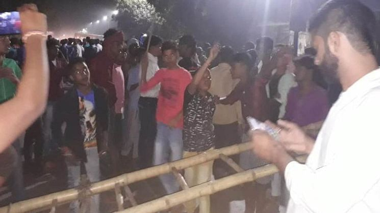 Locals stage protest on the Agra-Aligarh highway in Hathras district.