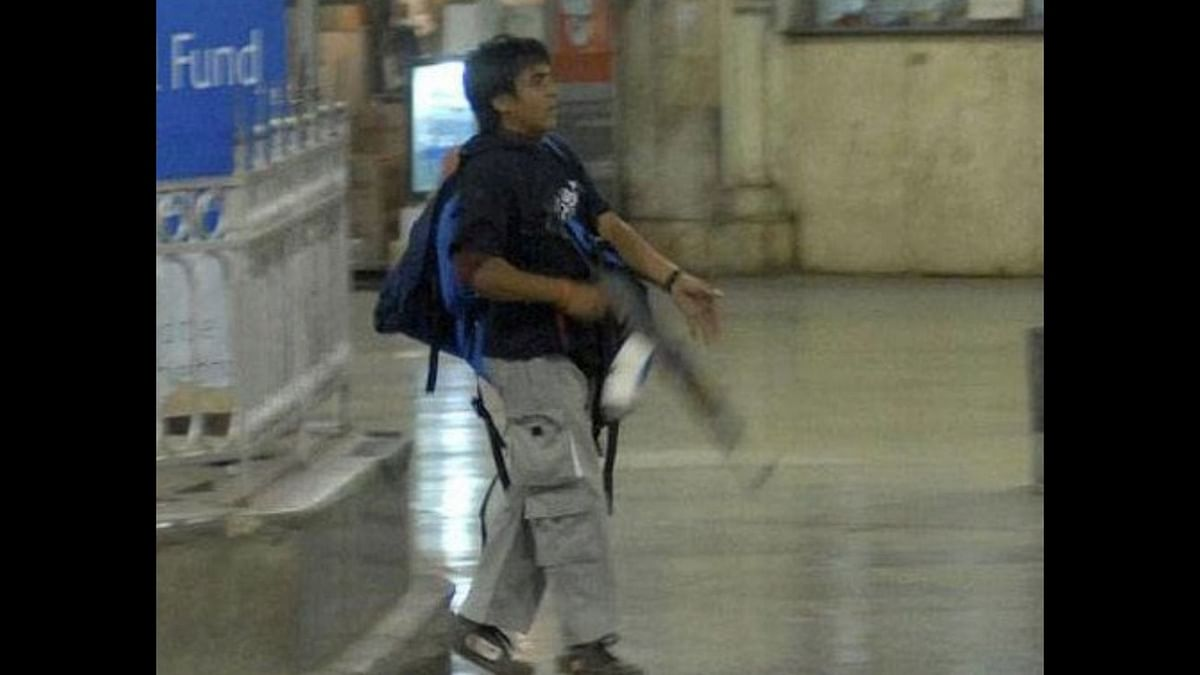 File image of Ajmal Kasab during the 26/11 Mumbai terrorist attack. One can see the red string tied around Kasab's wrist.