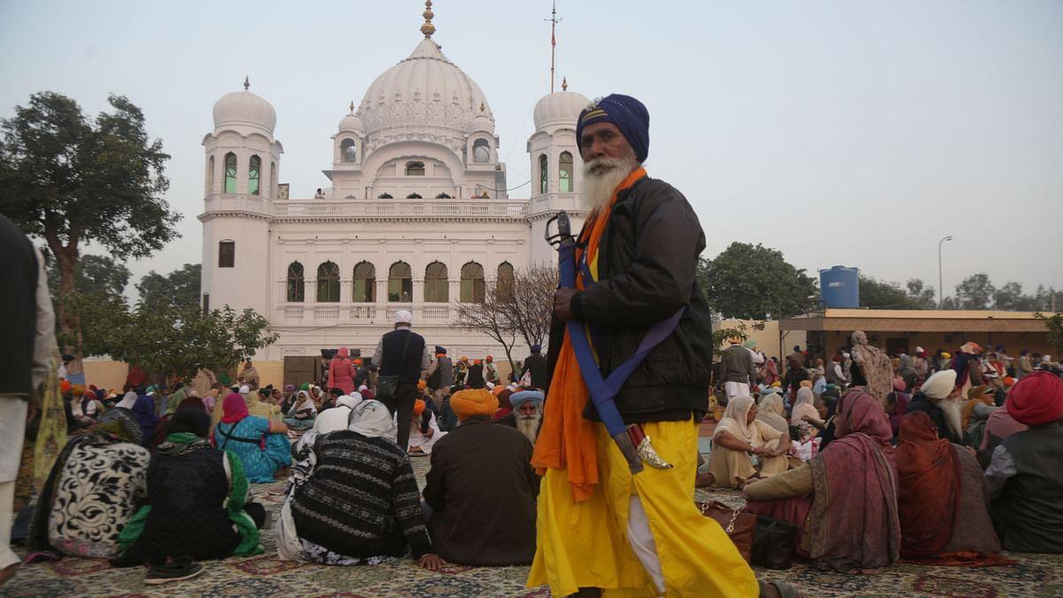 A Sikh pilgrim visits the shrine of their spiritual leader Guru Nanak Dev in Kartarpur, Pakistan, on Wednesday, 28 November.