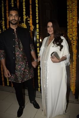 Mumbai: Actors Neha Dhupia and Angad Bedi during a Diwali party hosted by Ekta Kapoor at her residence in Juhu, Mumbai on Nov 6, 2018. (Photo: IANS)
