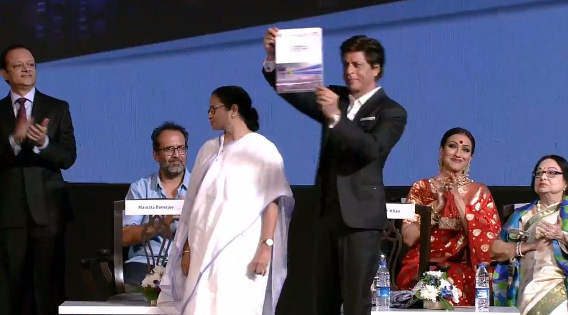 Shah Rukh also presented a book with Mamta Banerjee at the film festival.