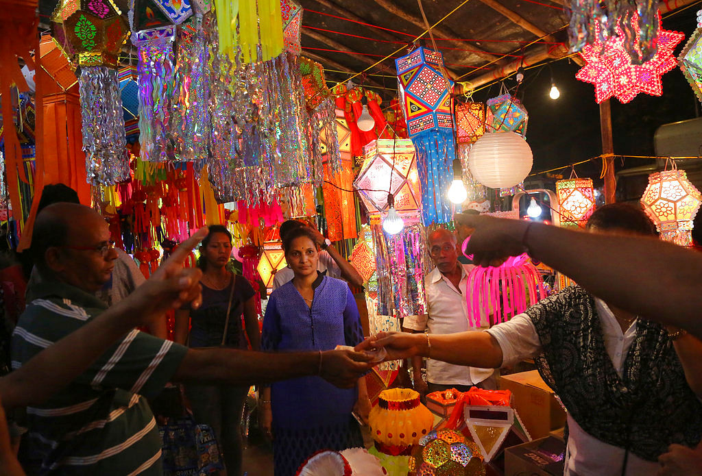 People shop for lanterns at roadside stalls ahead of Diwali, the Hindu festival of lights, in Mumbai.