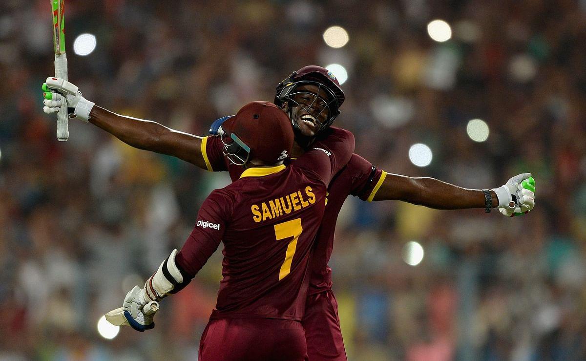 Carlos Brathwaite and Marlon Samuels celebrate after winning the 2016 ICC World T20.