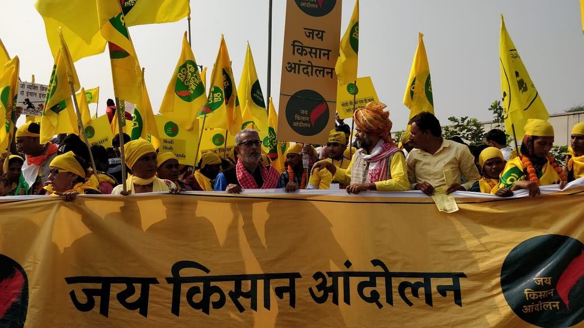 Protestors continue to walk towards Ramlila Maidan. Yogendra Yadav is seen leading the way.